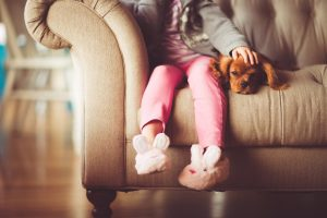 child and dog on sofa
